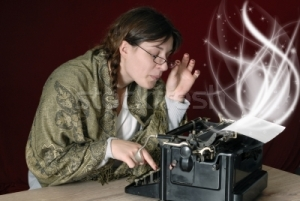 493999_stock-photo-female-author-typing-on-an-old-typewriter